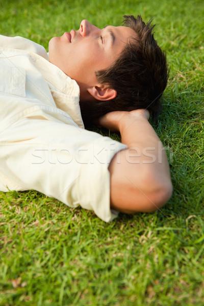 Yandan görünüş adam çim gözleri kapalı eller Stok fotoğraf © wavebreak_media