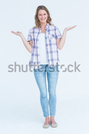 Portrait of a woman pointing at a copy space against a white background Stock photo © wavebreak_media