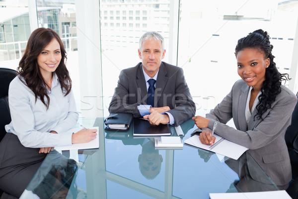 Grave direttore seduta desk due sorridere Foto d'archivio © wavebreak_media