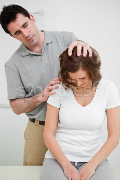 Physiotherapist moving the head of a patient in a medical room Stock photo © wavebreak_media