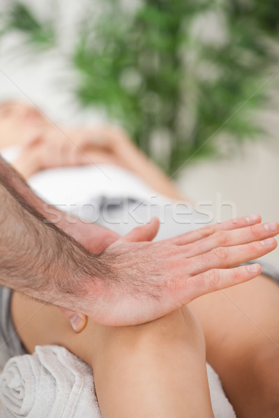Osteopath using his hand palm to massage a knee in a medical room Stock photo © wavebreak_media