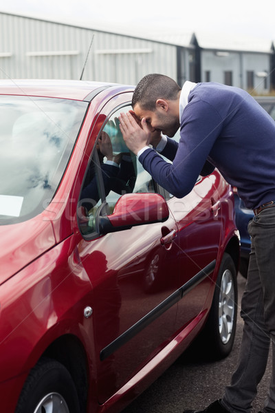 Man looking through the window of the car outdoors Stock photo © wavebreak_media