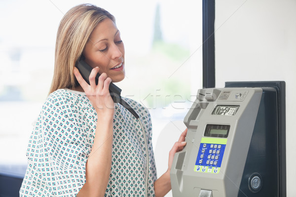 Female patient using payphone in hospital corridor Stock photo © wavebreak_media