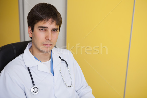 Doctor sits in yellow office on leather chair in hospital Stock photo © wavebreak_media