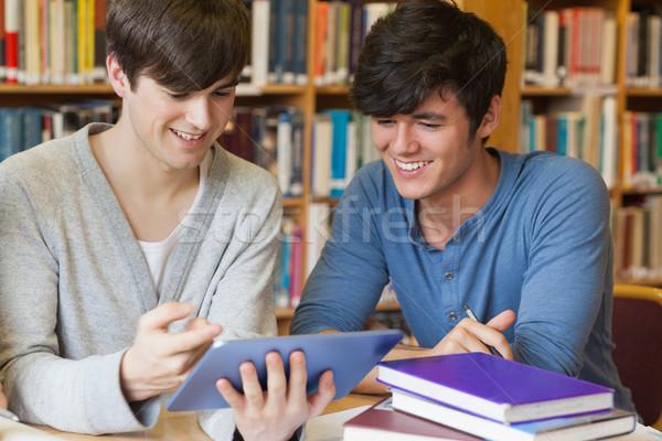 Öğrenciler oturma kütüphane büro bakıyor Stok fotoğraf © wavebreak_media