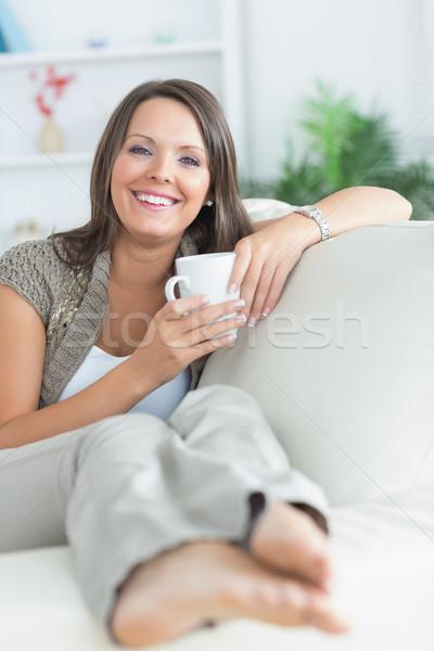 Mutlu kadın içme kupa kanepe oturma odası Stok fotoğraf © wavebreak_media