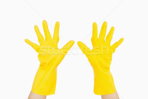 Mani indossare giallo guanti di gomma donna Foto d'archivio © wavebreak_media