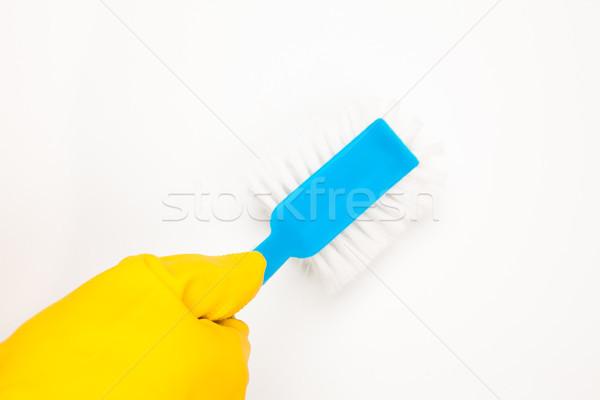Hand in rubber glove using blue scrubbing brush Stock photo © wavebreak_media