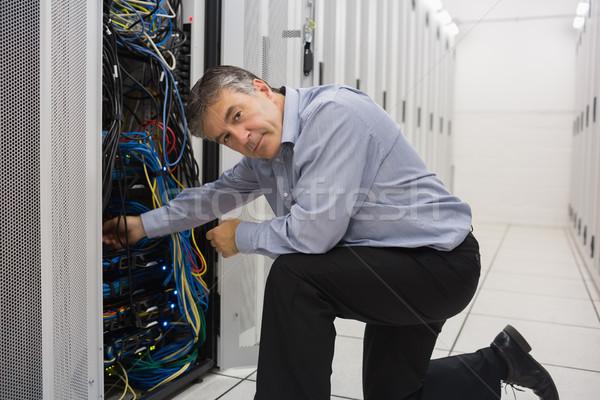 Technician kneeling and repairing a server Stock photo © wavebreak_media