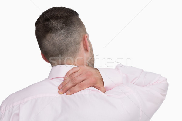 Rear view of business man with neck pain Stock photo © wavebreak_media