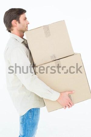 Giovane pacchetto scatole bianco ritratto Foto d'archivio © wavebreak_media