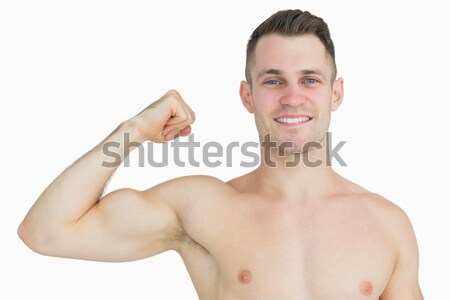 Portrait of shirtless young man flexing muscles Stock photo © wavebreak_media