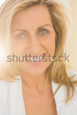 Close-up of beautiful young woman with blue eyes and blonde hair Stock photo © wavebreak_media