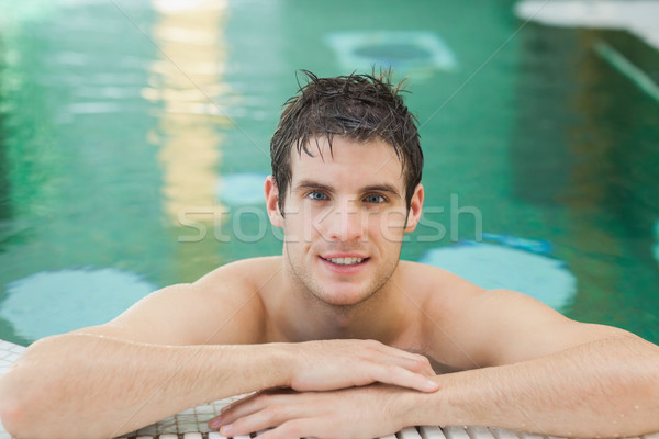 Smiling man in a swimming pool Stock photo © wavebreak_media