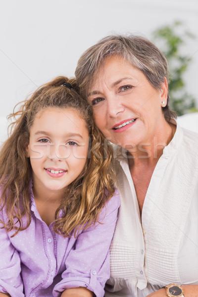 Portrait enfant grand-mère séance chambre maison Photo stock © wavebreak_media