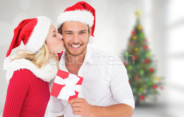 Stock photo: Composite image of young festive couple