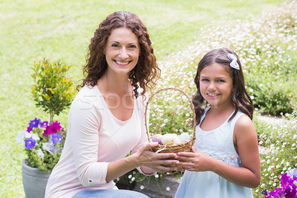 Happy mother and daughter collecting easter eggs Stock photo © wavebreak_media