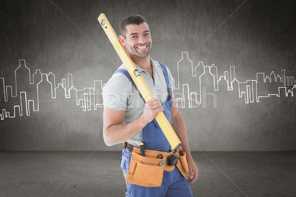 Composite image of worker holding spirit level Stock photo © wavebreak_media