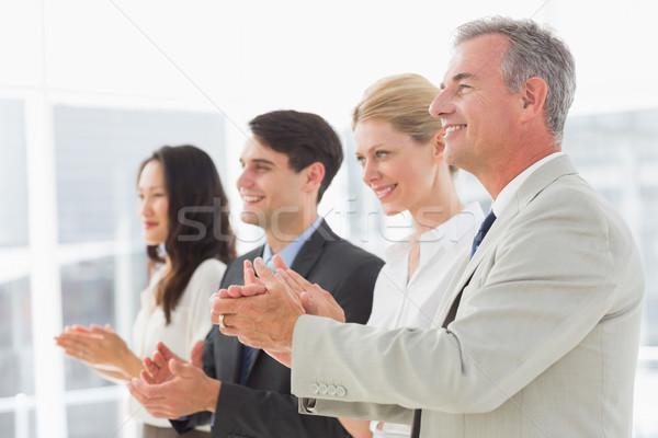 Business team standing in a line applauding Stock photo © wavebreak_media