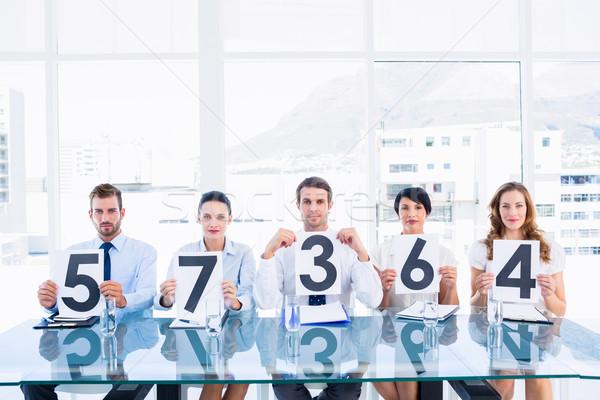 Gruppe Panel halten Punktzahl Zeichen Porträt Stock foto © wavebreak_media