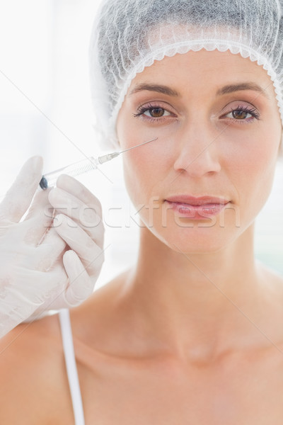 Attractive woman having botox injection Stock photo © wavebreak_media
