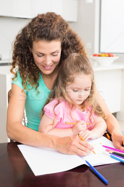 Mother and daughter colouring together at the table Stock photo © wavebreak_media