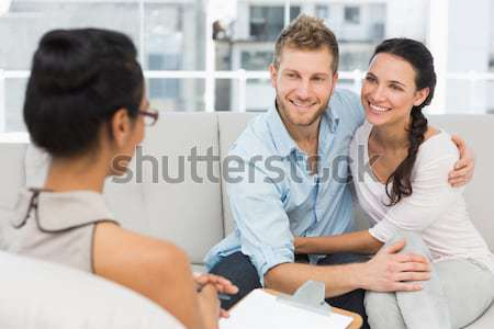 Happy couple reconciling at therapy session Stock photo © wavebreak_media