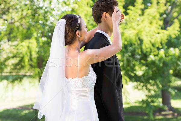 Young bride covering eyes of groom in garden Stock photo © wavebreak_media