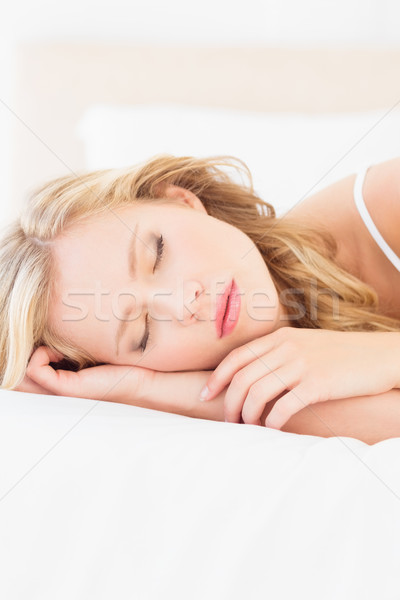 Natural young blonde lying on her bed sleeping Stock photo © wavebreak_media