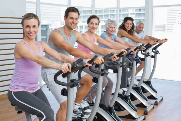 Happy people working out at spinning class Stock photo © wavebreak_media