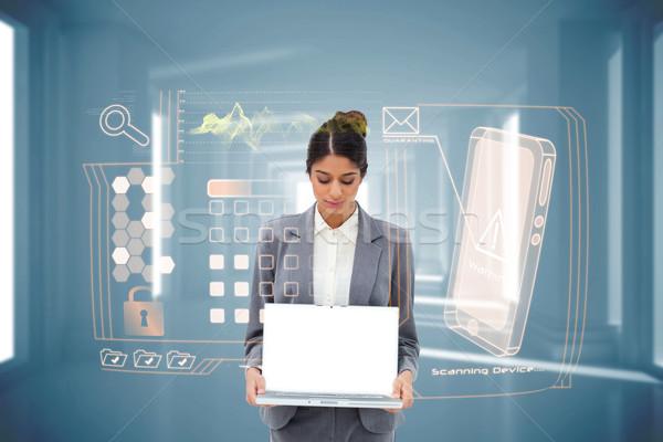 Femme d'affaires portable interface composite numérique affaires Photo stock © wavebreak_media