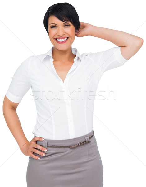 Stock photo: Thoughtful brown haired businesswoman in skirt