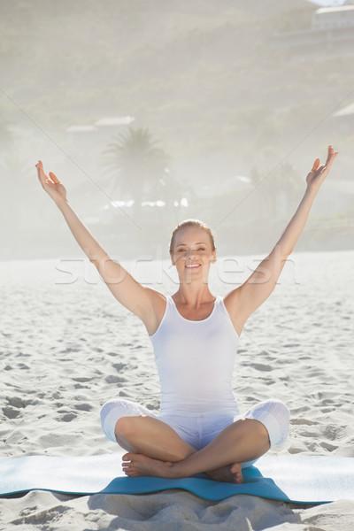 Gülümseyen kadın oturma lotus poz plaj Stok fotoğraf © wavebreak_media