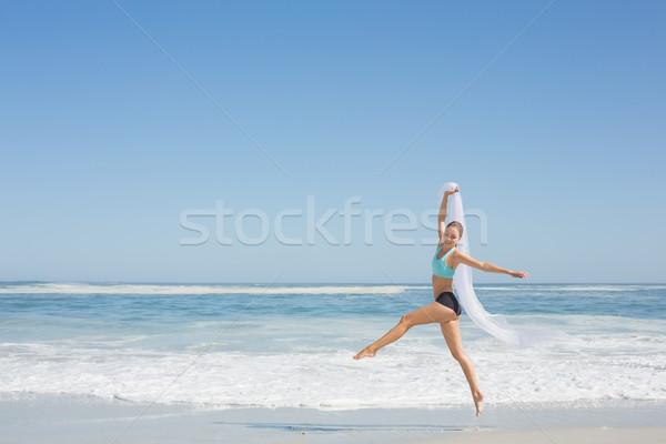 Dopasować kobieta skoki plaży szalik Zdjęcia stock © wavebreak_media
