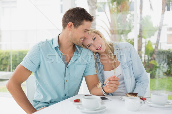 Hip young couple having desert and coffee together Stock photo © wavebreak_media