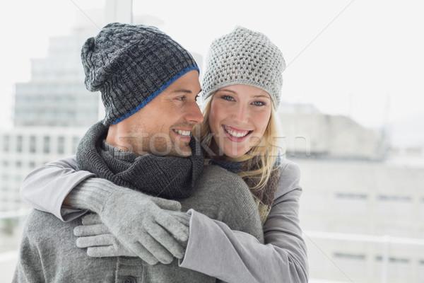 Cute пару теплая одежда женщина улыбается камеры Сток-фото © wavebreak_media