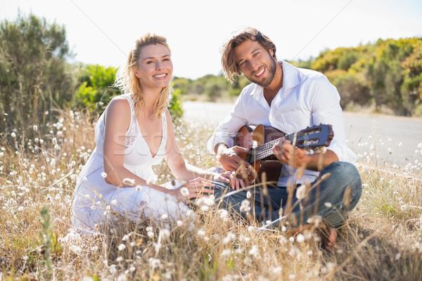 Homem bonito namorada guitarra feliz feminino Foto stock © wavebreak_media