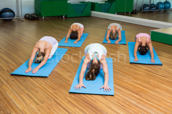 Yoga class in childs pose in fitness studio Stock photo © wavebreak_media