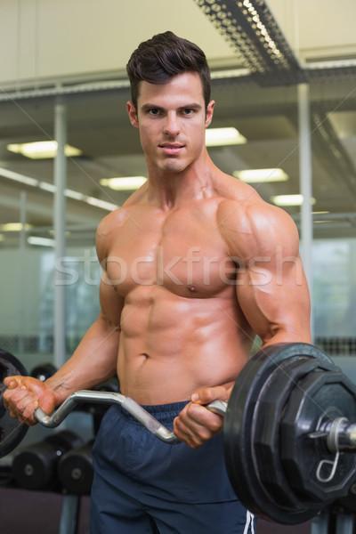 Shirtless muscular man lifting barbell in gym Stock photo © wavebreak_media