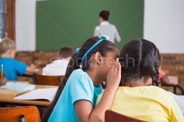 Aranyos iskolás suttog osztályterem általános iskola iskola Stock fotó © wavebreak_media