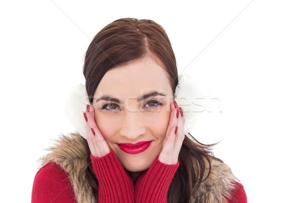 Brunette in winter clothes smiling at camera Stock photo © wavebreak_media