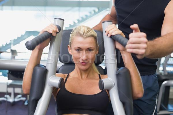 Fit woman using fitness machine at gym Stock photo © wavebreak_media