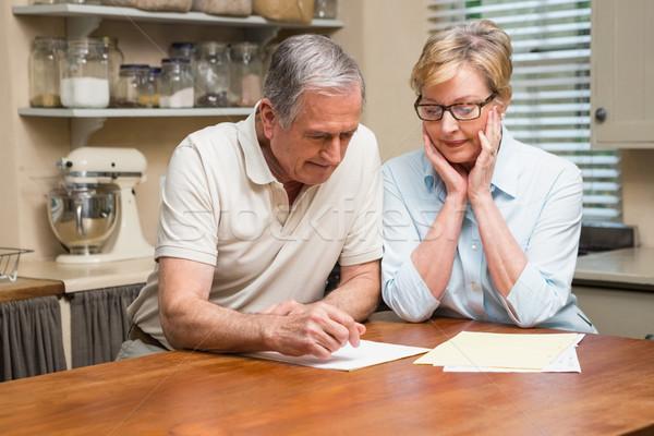 Senior couple working out their bills Stock photo © wavebreak_media