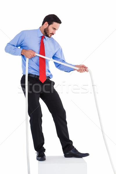 Focused businessman pulling a rope Stock photo © wavebreak_media