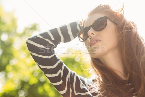 Beautiful woman looking away in park Stock photo © wavebreak_media