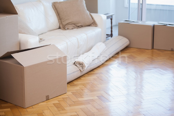 Rolled up carpet and boxes Stock photo © wavebreak_media
