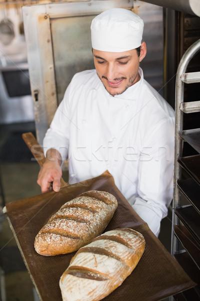 Feliz Baker bandeja frescos pan Foto stock © wavebreak_media