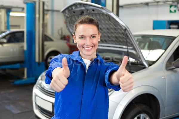 Mechanic smiling at the camera Stock photo © wavebreak_media