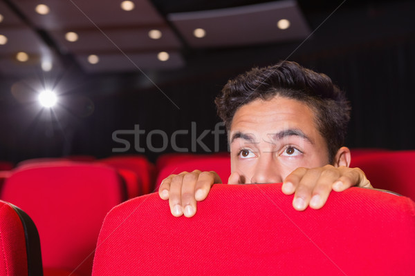 Young man watching a scary film Stock photo © wavebreak_media