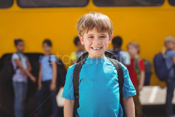 Bonitinho alunos sorridente câmera ônibus escolar fora Foto stock © wavebreak_media